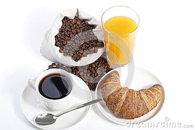 French breakfast from coffee cup with orange juice