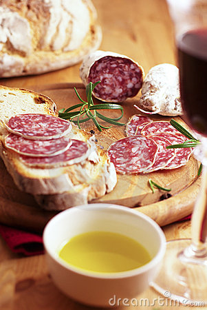 French dry sausage with bread and wine