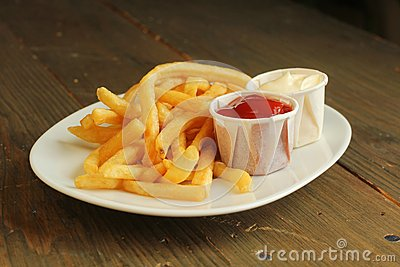 French fries with condiment