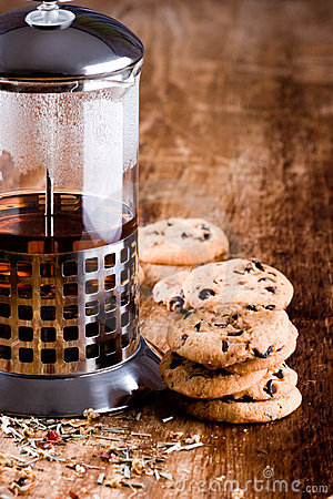 French press with hot tea and fresh baked cookies