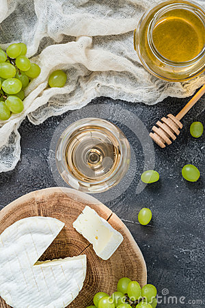 Free French Soft Cheese From Normandy Region Sliced On A Wooden Cut With Green Grapes, Honey, Spoon And Glass Of White Wine Stock Photo - 92017640