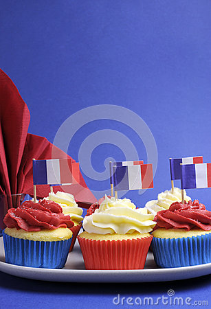 French theme red, white and blue mini cupcake cakes with flags of France - vertical.