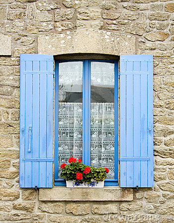 French window with blue shutters