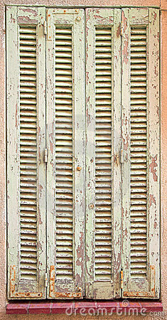 French window with closed shutters