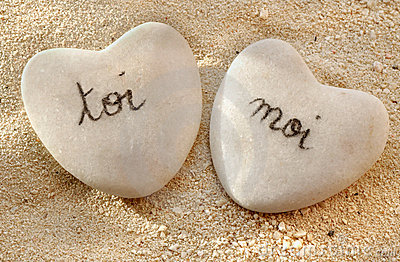 French you and me hearts of pebbles in the sand