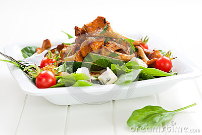 Fresh baby spinach with roasted chanterelle