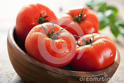 Fresh beef tomatoes in bowl