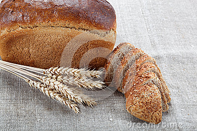 Fresh bread with ears of wheat.