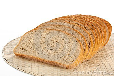 Fresh bread sliced on a place mats