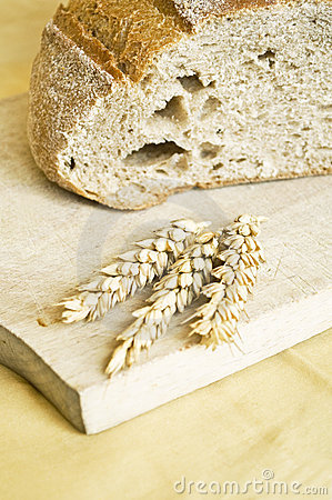 Fresh bread and wheat spikes