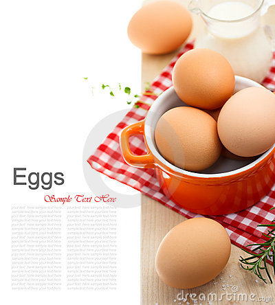 Fresh brown eggs with milk