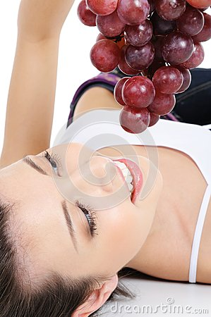 Fresh bunch of grapes in human hands