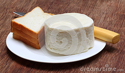 Fresh cheese with bread and kitchen knife