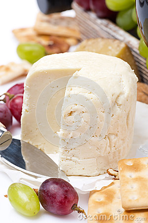 Fresh cheese, crackers and fruit, close-up