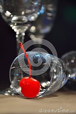 Fresh cherry on glass of wine