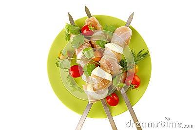 Fresh chicken kebabs on dark
