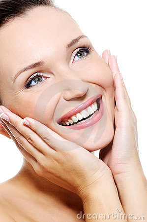 Fresh clean female face with a beaty whitest smile