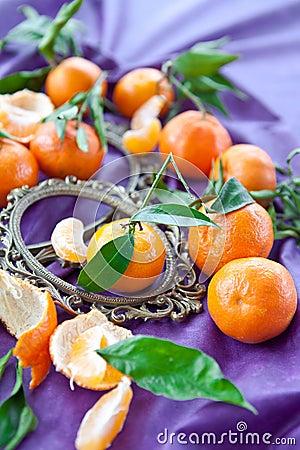 Fresh clementines on purple