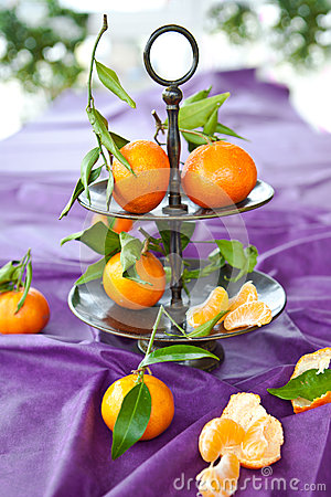 Fresh clementines on purple