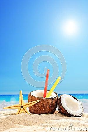 Fresh coconut cocktail on a sandy beach