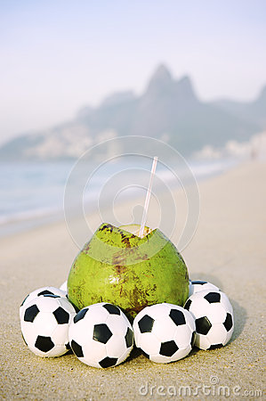 Fresh Coconut with Football Soccer Balls on Beach in Rio