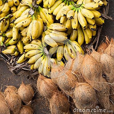 Fresh coconuts and bananas at market place