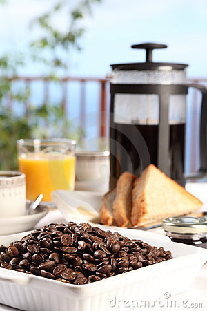 Fresh coffee at breakfast table on a sunny morning