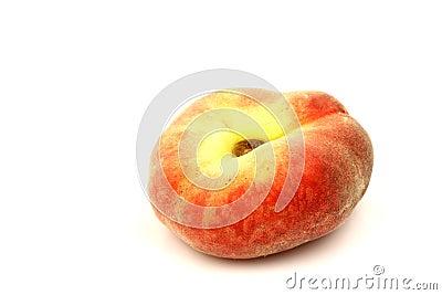 Fresh colorful flat peach (donut peach)