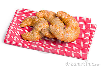 Fresh croissants on checkered napkin
