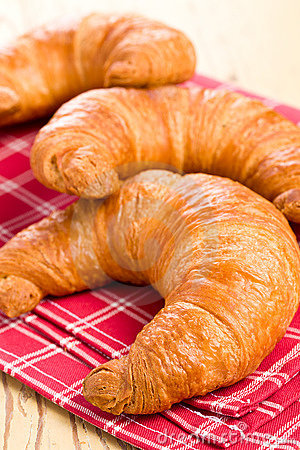 Fresh croissants on checkered napkin