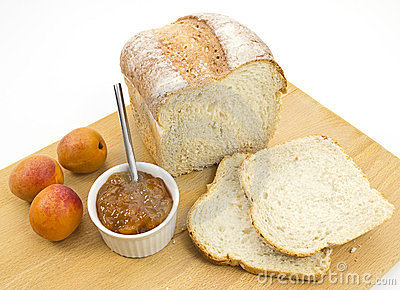 Fresh crusty farmhouse bread with apricot conserve