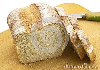 Fresh crusty farmhouse bread on board