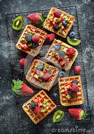 Free Fresh Egg Waffles Dessert For Breakfast With Fruits Strawberries, Blueberries, Blackberries, Raspberries And Kiwi Stock Images - 113545004