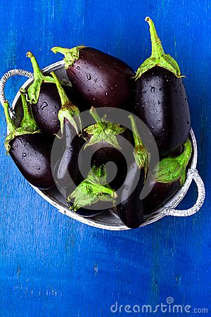 Free Fresh Eggplant In Grey Basket On Blue Wooden Table.Rustic Background. Top View. Copy Space. Vegan Vegetable. Royalty Free Stock Image - 100187686
