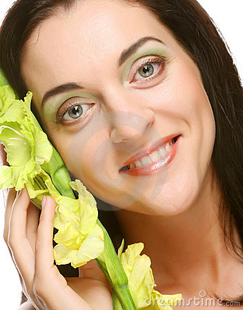 Fresh face with gladiolus flowers in her hands