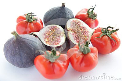 Fresh figs and tomatoes for salad on white backgro