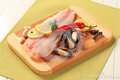 Fresh fish fillets and mussels