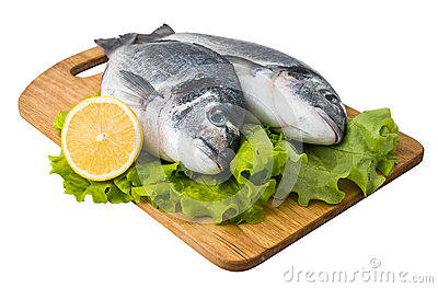 Fresh fish on wooden cutting