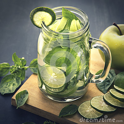 Free Fresh Fruit Flavored Infused Water Mix Of Apple, Lime And Basil Stock Images - 56940824