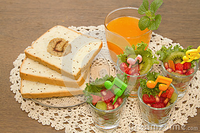 Fresh fruit salad with orange juice, fusion food