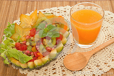 Fresh fruit salad with orange juice, fusion food