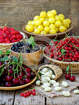 Free Fresh Fruits And Berries In The Basket On Wooden Background Stock Photos - 73668253