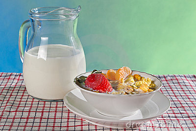 Fresh fruits with corn flakes and milk jug