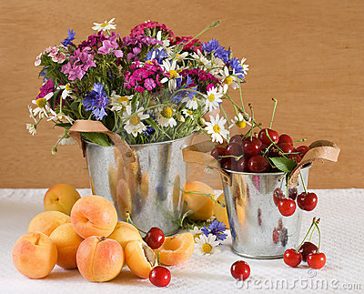 Fresh fruits and wild flowers