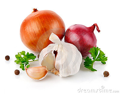 Fresh garlic fruits with green parsley