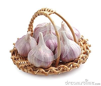 Fresh garlic in a wicker basket