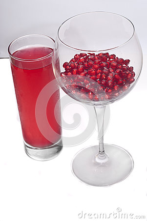 Fresh grains and juice pomegranate in glass
