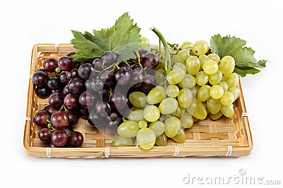 Fresh grape fruits with green leaves isolated.