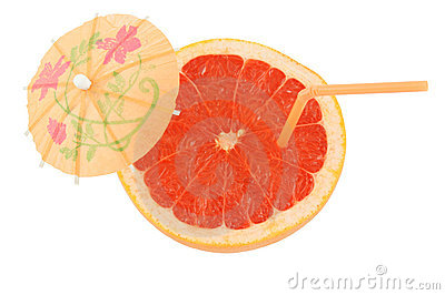 Fresh grapefruit with straw and umbrella
