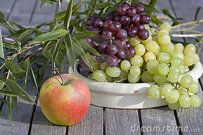 Fresh grapes and red apples outdoor